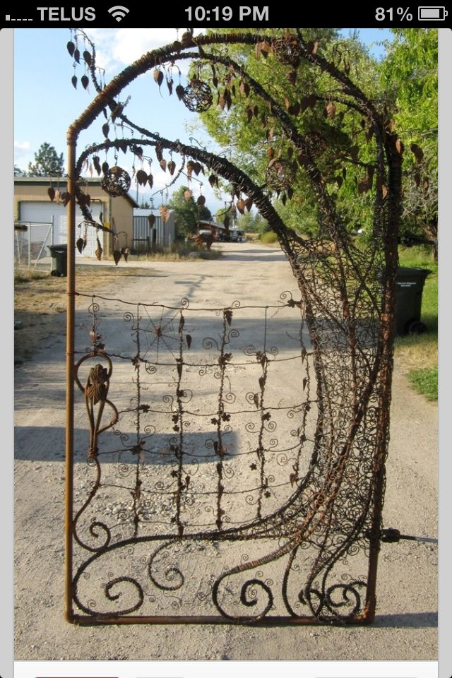 Unique garden gate re bar old fencing barbed