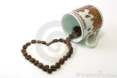 Heart of coffee with sugar inside arising from a cup