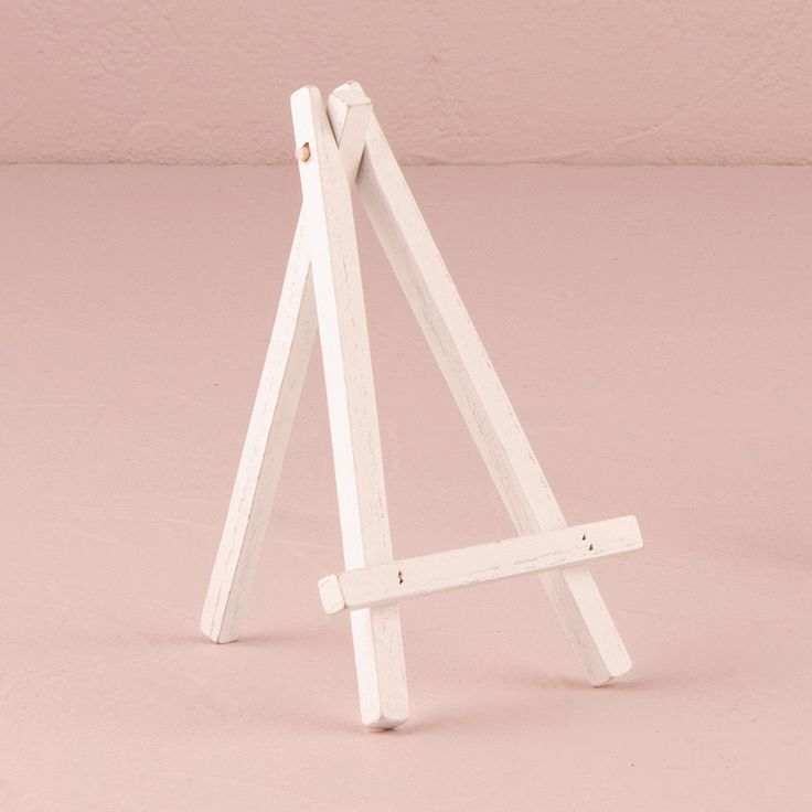 Use these display easels with chalkboards or stationery to create a charming effect. The simple all white design makes these adaptable for a wide range of color palettes and wedding styles. Here is a