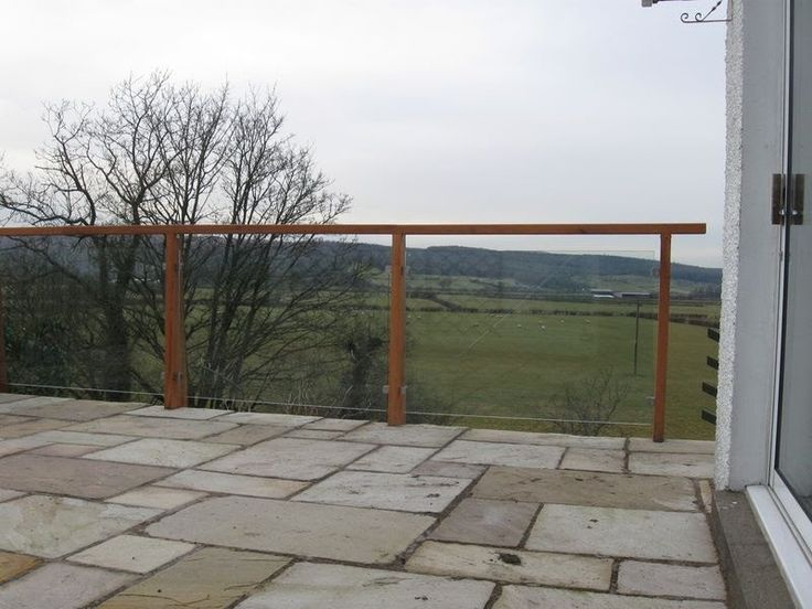 Stone Patio Terrace with Glass Balustrade and Timber and Wire Trellis - English Country Gardens Cumbria