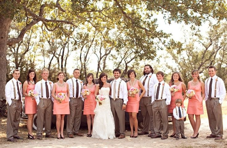 The combination of the soft brown with coral gives this wedding photo and earthy and country western feel. The suspenders also give them groomsmen a vintage look. Alexandra W.