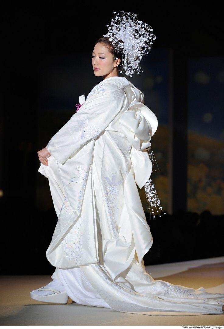 Japanese pop singer Ayaka Hirahara shows off a wedding kimono by Japanese bridal designer Yumi Katsura