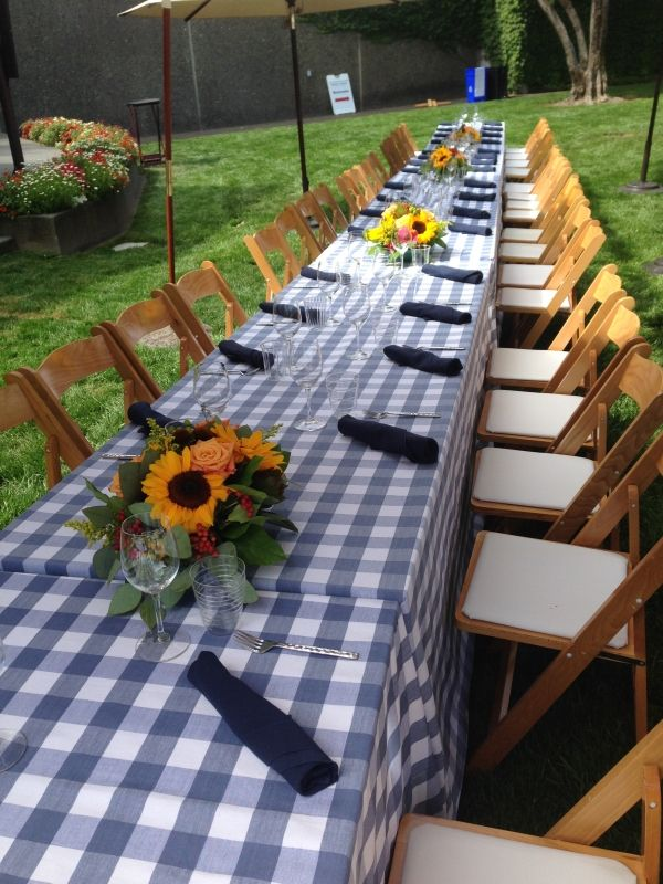 The perfect outdoor event combination: Sunflowers and checkered tablecloth! #winecountry