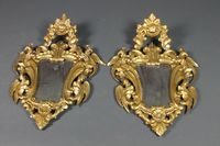 """Lot No 953 A pair of 19th Century Rococo style carved gilt wood framed mirrors 30""""h x 19 1/2""""w, sold for £340"""