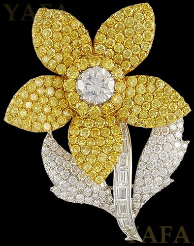 "18k white gold diamond and yellow diamond flower brooch, signed Graff. Approx. 2 1/2"" x 2"""