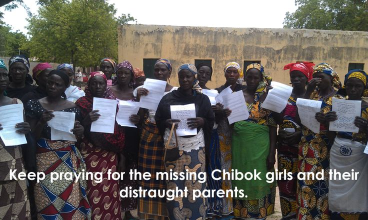 Mothers of the missing Chibok girls holding up prayers from Open Doors supporters.