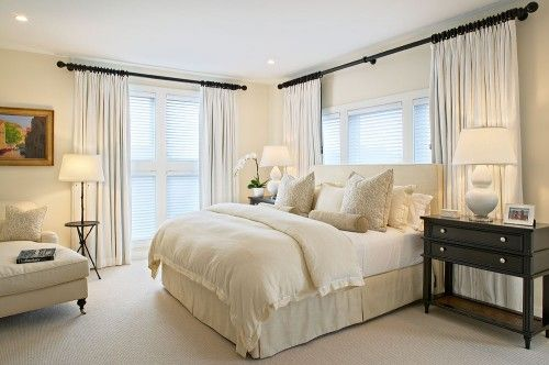 1. Creamy white. A white bedroom can be a very relaxing haven. For best results, use a few different tones of white and layer them in the space. In this bedroom, creamy white walls are combined with crisp white curtains and ivory colored bedding. This type of variation will prevent your space from looking too stark. Paint pick: Dover White 6385 by Sherwin-Williams