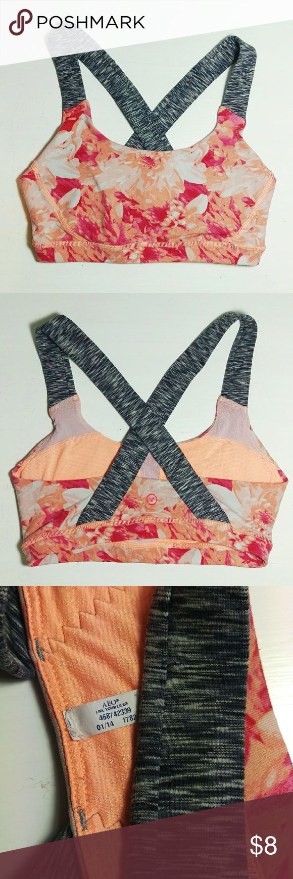 """American Eagle Floral Cross-Back Sports Bra This versatile floral orange and red sports bra is extremely beautiful and supportive. I wore this mostly for yoga or light intensity workouts and they look great under any tank. It's like new still. Sizing: fits a XS or S with 28-32"""" chest and A-B cup. American Eagle Outfitters Intimates & Sleepwear Bras"""