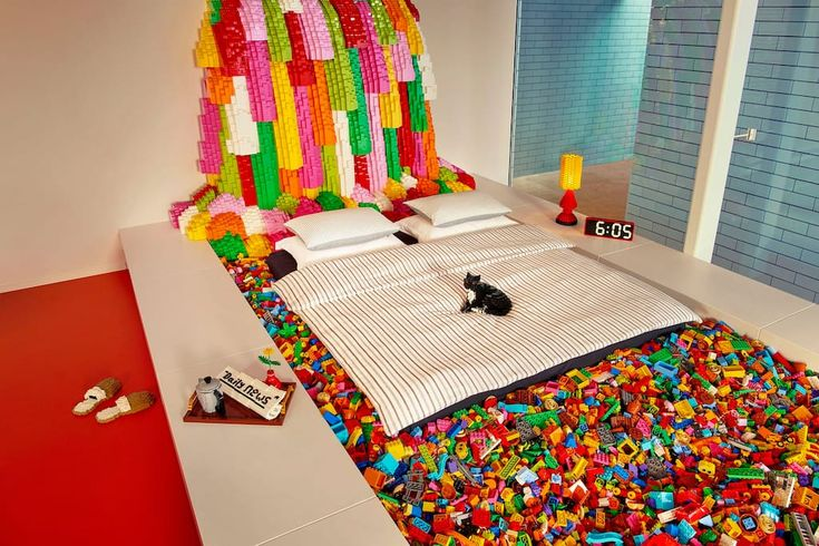 Meanwhile, parents get to sleep in a bed that floats in a pool filled with DUPLO bricks.
