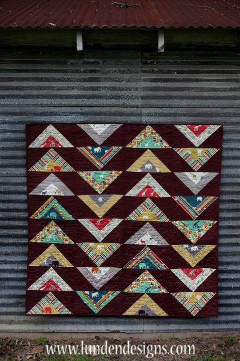 This fabulous quilt pattern is a new twist on the classic flying geese design. Show off your gorgeous prints with this high impact pattern. The pattern