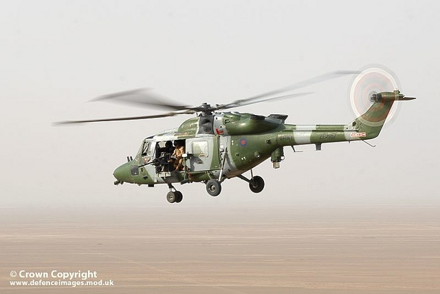 A Lynx Mk 9A helicopter flying over the desert in Helmand province, Afghanistan.