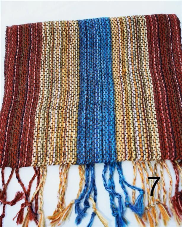 This Striped Handwoven Alpaca Scarf has a unique weighted feel for a lightweight accent item. Soft and colorful, without being too loud. Detailed color patterns give this item its vibrant look. Highli