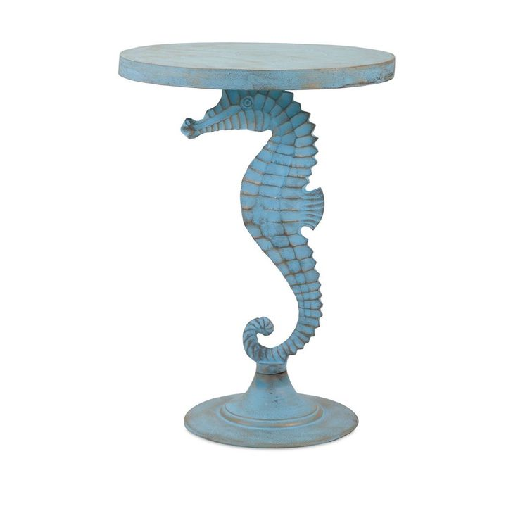 this coastal accent table features a seahorse base with a weathered finish materials aluminium item dimensions 25 inch h x 18 inch d