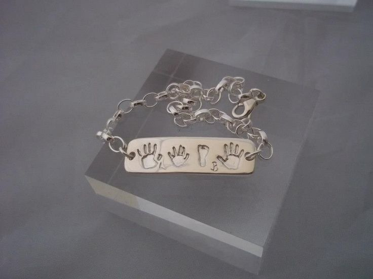 A gorgeous fine silver ID tag with a sterling silver bracelet. Featuring hand and footprints. Fully personalised keepsake