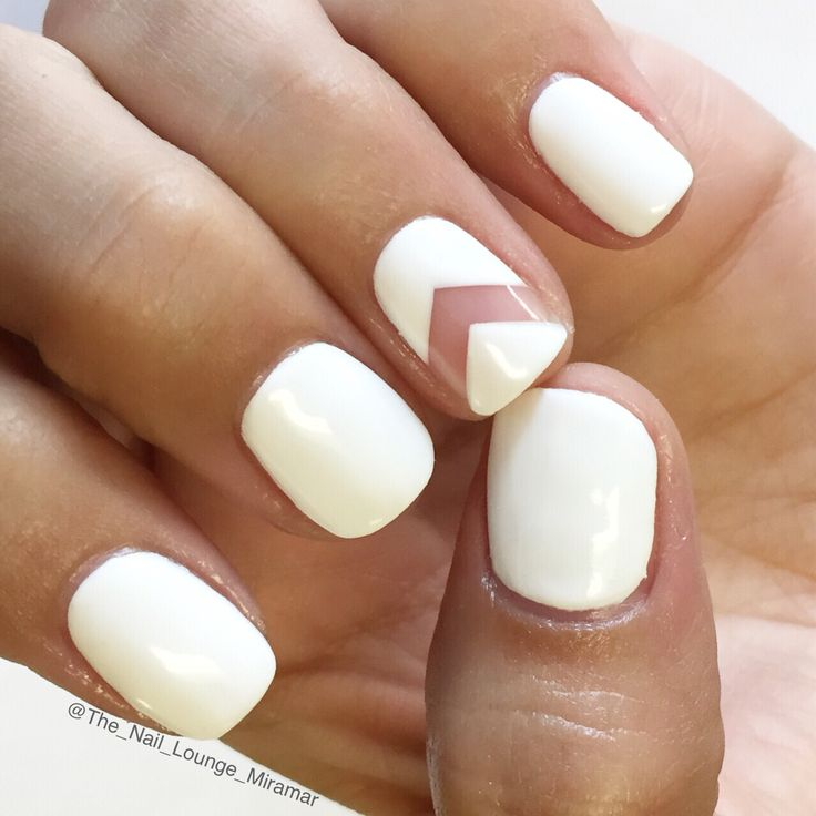 White chevron negative space nail art design