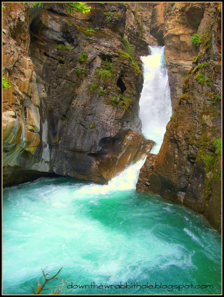 "The beautiful Lower Falls of Johnson Canyon in Banff, Alberta. Find out more at ""Down the Wrabbit Hole - The Travel Bucket List"". Click the image for the blog post."
