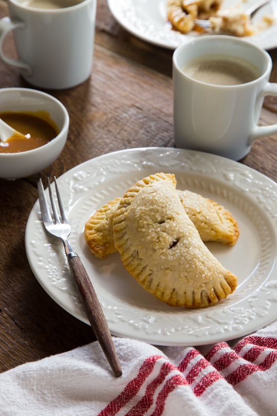 Apple Hand Pies are everything you love about fall, in one tiny, edible package. Flaky, tender pie crust with warm and spicy apple pie filling will just make your day!
