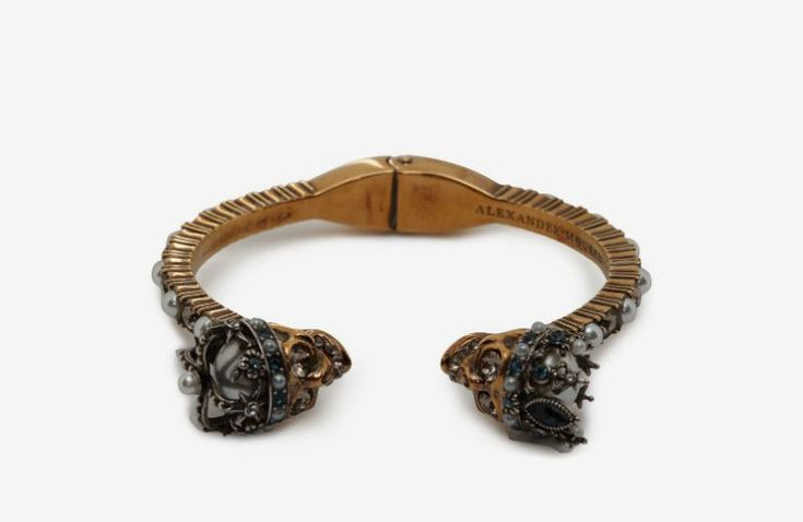 Queen and King Twin Skull Bracelet by Alexander McQueen ➤ Discover more luxury lifestyle news at www.covetedition.com @covetedition #covetedmagazine @covetedmagazine #luxurylifestyle #alexandermcqueen #jewellery