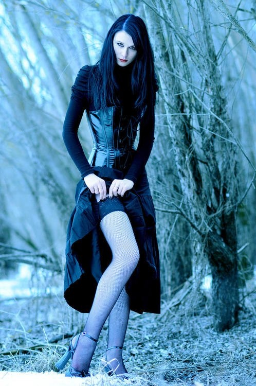 #Goth girl tempting with her lovely legs