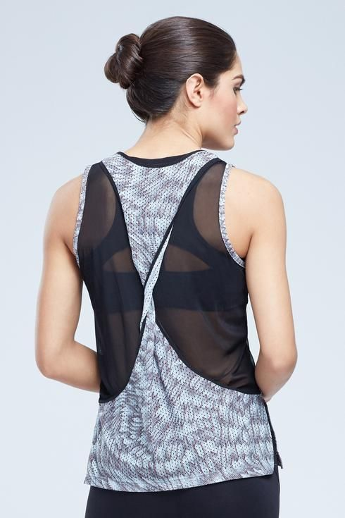 Our Maines Singlet Tank is bringing sexy back, literally! Mesh insets and a twisted racerback make this perfect a night in the gym or out on the town.