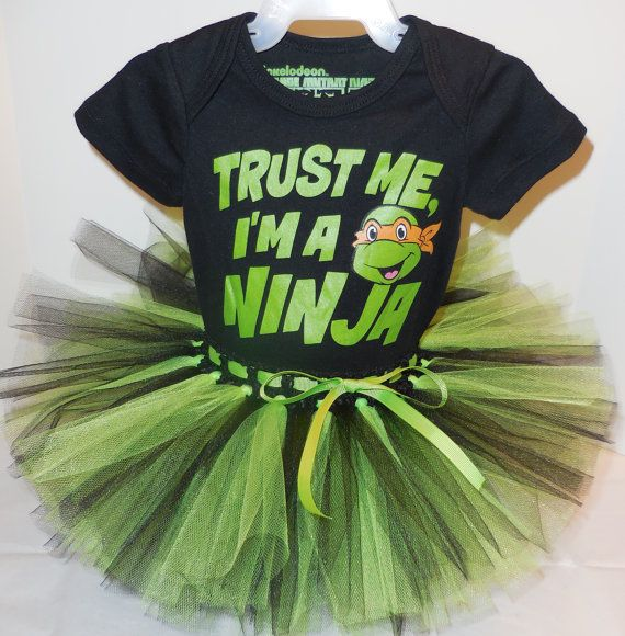 Adorable new black s/s onesie with Trust Me, Im a Ninja printed on the front. Includes a handmade black and bright green tulle tutu on a stretchy