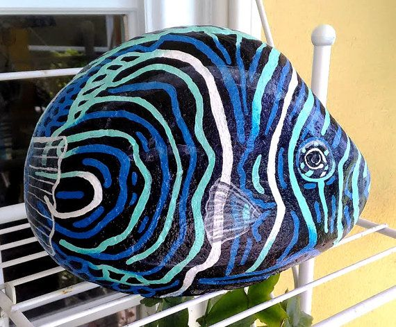 STONEIMALS: This beautiful bright Koran Angel fish is ready to purchase for a home!  Great for a centerpiece, doorstop, bookend, bathroom decor, bedroom, pool patio decor...  Size : 8l x 6h 1 1/2 wide.  Painted in rich blue and aqua acrylics and coated with a UV protective varnish for a lifetime of enjoyment. Size: Shipping in US is USPS Flat Rate with tracking and insurance. International is USPS Flat Rate with insurance. ( Bubble wrapped )  Thank you for viewing my artwork and God Bles...