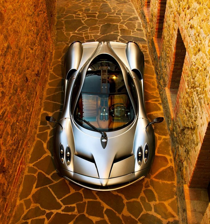 "The Pagani Huayra is an Italian mid-engined sports car produced by Pagani. Succeeding the company's previous offering, the Zonda, it costs $1,314,000. It is named after Huayra-tata, a Quechua wind god. The Huayra was named ""The Hypercar of the Year 2012"" by Top Gear magazine and received a very positive review when tested by Richard Hammond on Top Gear. The Huayra is currently the fastest road car to go around the Top Gear Test Track setting a record time of 1:13.8."