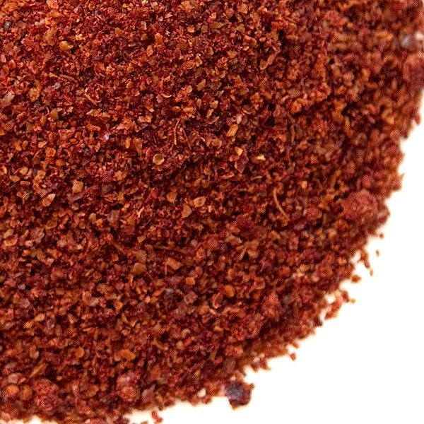 The aroma of sumac spice is reminiscent of feral raspberries and lemons. Sumac's main quality is not it's mild lemony flavor, but its intense sour taste.