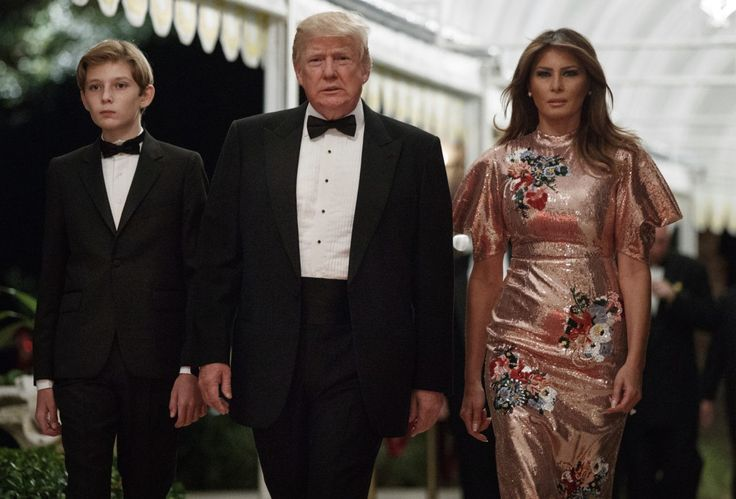 Melania celebrated alongside President Trump and their son, Barron, in a glittering party dress inspired by the Reagan era of the 1980s.
