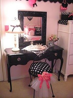 I just love the idea of using a table like this and turning it into a vanity (without all the black and frills though)! :)