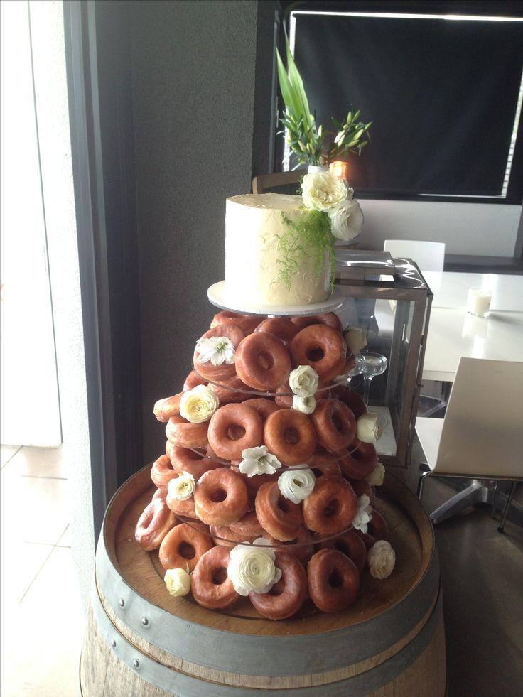 Handmade glazed donuts with cutting cake