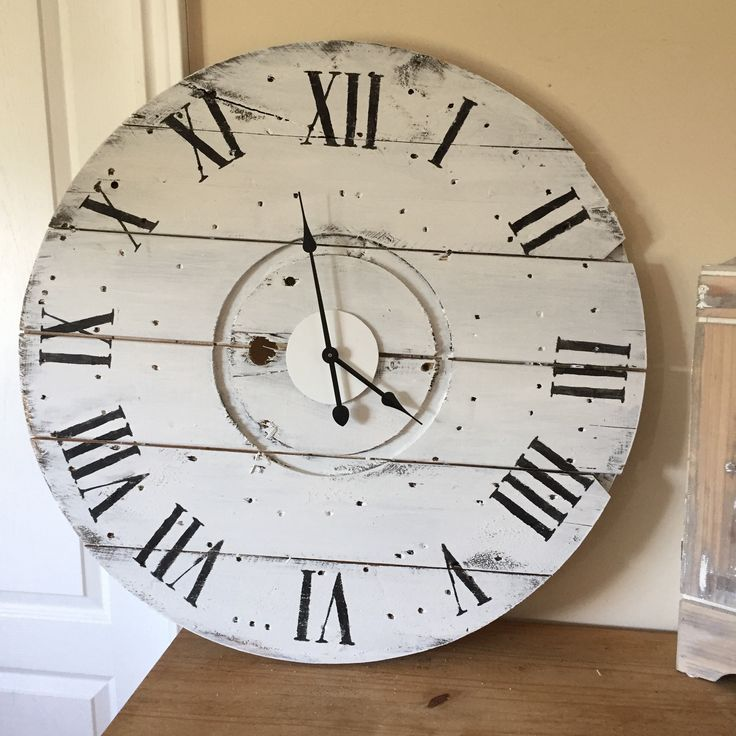 """Vintage White "" is one of the many beautiful rustic clocks we offer at our online boutique.  www.anchored4.com We ship world wide!!!  Sign up for our free Anchor Rewards Program to earn anchor points to get money off purchases or cash in anchor points to get items in our store FREE!!!"