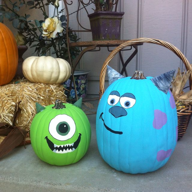 Fake pumpkins painted. Mike and Sully from Monsters, Inc.