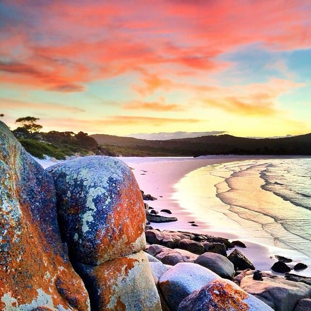 All the colours of sunset at Binalong Bay, near the town of St Helens on Tasmania's north-east coast.  Discover more about Binalong Bay at: http://www.discovertasmania.com.au/about/regions-of-tasmania/east-coast/binalong-bay #tasmania #discovertasmania #sunset #binalongbay #beach Image Credit: Paul Fleming