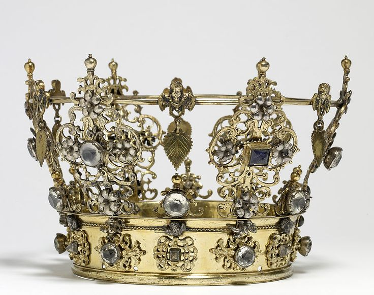 Bridal Crown or Brudkrona, Sweden (early 18th c.; silver-gilt, silver, paste gemstones). In Scandinavia, wedding crowns are worn by brides of all social strata. They are owned by the bride's parish and loaned for the occasion. Wedding crowns are richly decorated with emblems of conjugal love. This crown includes carnations (enduring marriage), dangling linden leaves (fertility), and angels (the eternal and spiritual qualities of marriage).