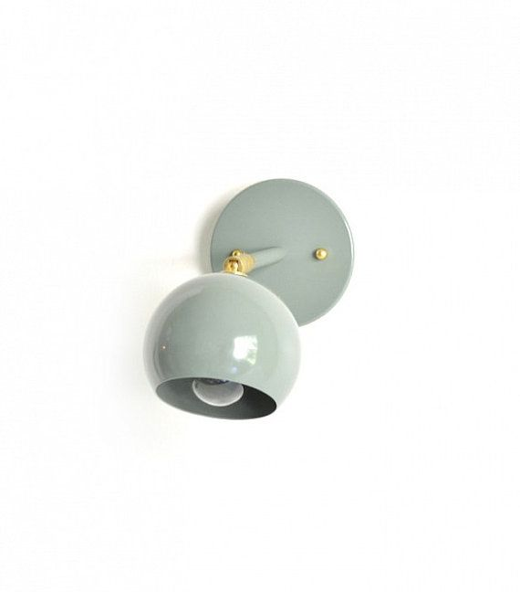 Newt.  Wall sconce lamp light.  Solid metal shade tilting brass light with bulb sage olive green UL Listed