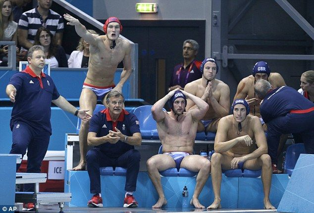 Agony: The British bench watches on as their team-mates slump to defeat against Serbia