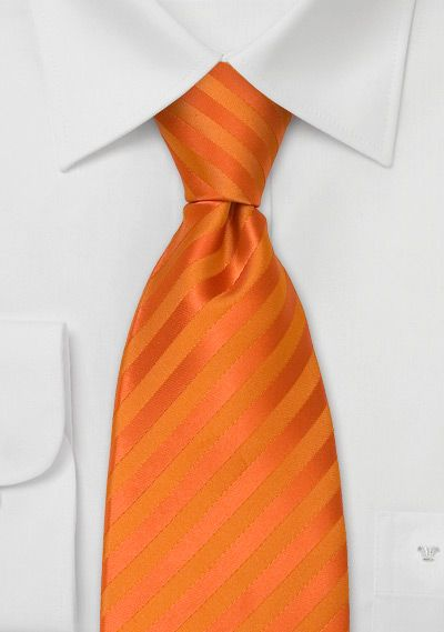 orange tie... seeing as I already know my wedding colors will be orange and pink, this is a great idea :)