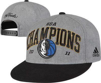 "Dallas Mavericks NBA Champions 2011 Adjustable Back Hat   ""NBA Champions 2011""  Official Locker Room Product Authentic NBA Merchandise Baseball Cap  Color: Gray and Black  MSRP: $27.99"
