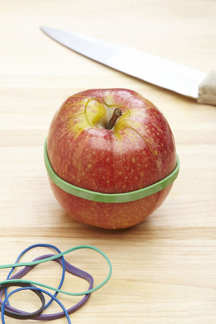 Once you've sliced the apple, put a rubber band around it to hold the apple together. It'll keep the apple from oxidizing, AKA turning that dingy brown color.