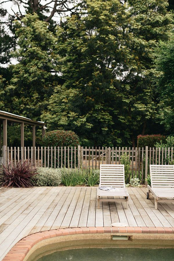simple picket fence, wood deck, and lounge chairs, simple but perfect