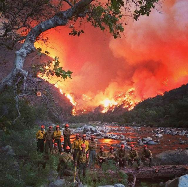 Great pic for a coffee table book, with both a water feature and a fire.  USFS photo of the Los Prietos Hot Shots at the Kings River on the Rough Fire. [California 2015] [Best crew picture ever | Wildfire Today] hotshots wildland firefighting firefighters Forest Service