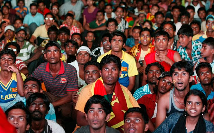 Sri Lankan cricket fans react as they watch India closing in to beat Sri Lanka in the Cricket World Cup final match, in Colombo, Sri Lanka, Saturday, Apr 2, 2011. (AP Photo/Gemunu Amarasinghe)