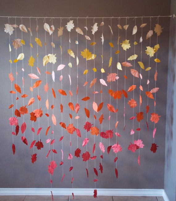 This cascading paper leaf garland displays a gorgeous range of fall hues. It would be beautiful as a wedding ceremony backdrop/reception decor, as a window display for a store, or as wall decor in the home. The leaves are hand-cut from paper and then dip-dyed to create the ombre effect. The color fades from beige to gorgeous shades of mustard yellow, burnt orange, and maroon. This display features a vertical ombre (fade from top to bottom), but I can also create a display with a horizontal…