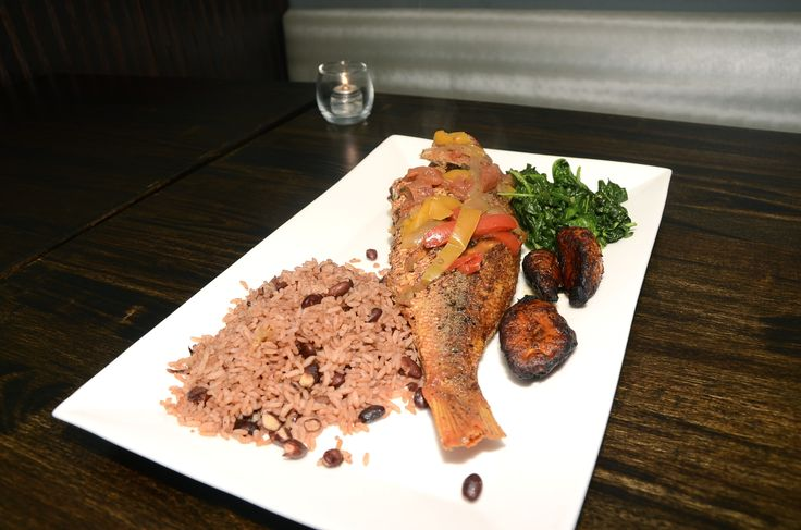 "The Society Restaurant & Lounge ""Calypso Red Snapper"" Deep fried signature whole Red Snapper/Tangy calypso sauce/ Sauteed spinach/Rice and Peas/Plantians.... #foodheaven, #fooderrific, #foodgasm, #foodreview #sogood, #delish, #delicious, #tasty, #yummy and #yumyum #FDLmoment — at Society Restaurant & Lounge...."