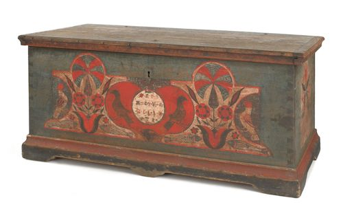 "Pennsylvania painted dower chest, dated 1780, the front with a central red heart with oval inset and two birds flanked by stylized floral trees arising from hearts and two birds, all over four spotted fish, the ends with facing birds and tulips, resting on straight bracket feet, 22"" h., 46"" w., 22 1/4"" d. Illustrated in Schaffner & Klein Folk Hearts, fig. 71 and The Pennsylvania Germans A Celebration of the Arts, fig. 35. Provenance: Collection of Richard and Rosemarie Machmer, Pook & Pook…"
