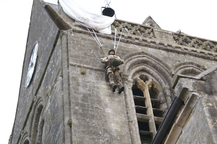 JK  Ste. Mere Eglise US paratrooper caught on church steeple for 2 hours before Germans took him down alive.