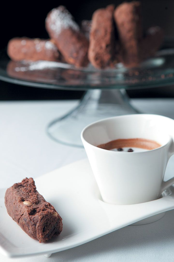 The chocolate rusks keep it South African, but chocolate is not something you see often in a rusk. We've paired it with a caffè macchiato.