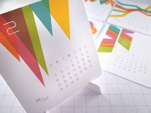 Desktop calendar with geometric shapes.