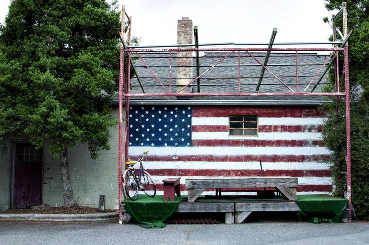 "A ""Patton"" American flag — reminiscent of the iconic opening scene in the oft-quoted film — backdrops Tyler's Restaurant & Taproom outdoor stage in Carrboro."